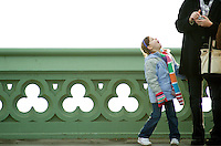 Little girl begging her mother on the bridge.