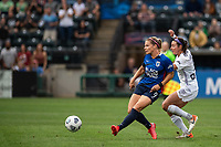 TACOMA, WA - JULY 31: Eugenie Le Sommer #9 of the OL Reign takes a shot on goal during a game between Racing Louisville FC and OL Reign at Cheney Stadium on July 31, 2021 in Tacoma, Washington.