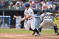 Asheville Tourists third baseman Michael Benjamin #18 swings at a pitch during a game against the Charleston RiverDogs at McCormick Field July 26, 2014 in Asheville, North Carolina. The Tourists defeated the RiverDogs 9-6. (Tony Farlow/Four Seam Images)