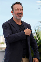 """CANNES, FRANCE - JULY 17: French actor Jean Dujardin at photocall for the film """"OSS 117 : Alerte Rouge en Afrique Noire"""" (OSS 117 : From Africa With Love) at the 74th annual Cannes Film Festival in Cannes, France on July 17, 2021 <br /> CAP/GOL<br /> ©GOL/Capital Pictures"""