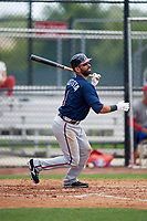 Atlanta Braves third baseman Jose Bautista (1) flies out to right field in the top of the third inning during a Minor League Extended Spring Training game against the Philadelphia Phillies on April 20, 2018 at Carpenter Complex in Clearwater, Florida.  (Mike Janes/Four Seam Images)