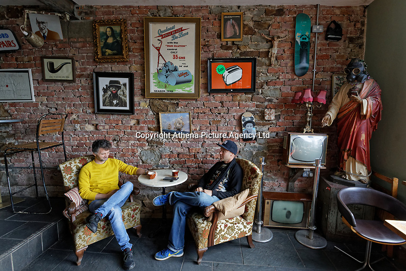 Pictured L-R: Manager Levente Jakab and owner Noah Redfern, kill time after doing some light maintenance work at Noah's Yard bar and cafe, which had to close down following instructions from Government, in the Uplands area in Swansea, Wales, UK. Saturday 21 March 2020<br /> Re: Covid-19 Coronavirus pandemic, UK.