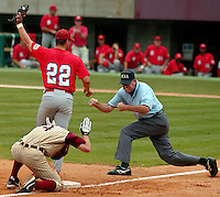 Florida State's #4 Stephen Drew reacts as he is called out by third base umpire Tim Catton after being tagged out by South Alabama third baseman #22 Kevin Sytko while trying to stretch a bases-loaded double into a triple during a NCAA baseball regional tournament game in Tallahassee, Fl.