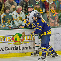 21 February 2015:  University of Vermont Catamount Defenseman Dan Senkbeil, a Junior from Fremont, CA, is checked by Merrimack College Warrior Defenseman Jonathan Lashyn, a Sophomore from Saskatoon, Saskatchewan, in the first period at Gutterson Fieldhouse in Burlington, Vermont. The teams played to a scoreless tie as the Cats wrapped up their Hockey East regular home season. Mandatory Credit: Ed Wolfstein Photo *** RAW (NEF) Image File Available ***