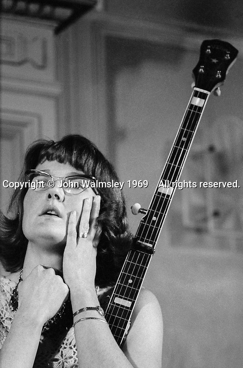 Peggy Seeger, song writer and performer (member of the North American folk Seeger family), at a folk club in London around the late 1960s.  If you can identify the venue, please let me know.