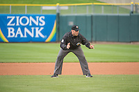 Base umpire Spencer Flynn during the game between the Tacoma Rainiers and the Salt Lake Bees at Smith's Ballpark on May 7, 2015 in Salt Lake City, Utah.  (Stephen Smith/Four Seam Images)