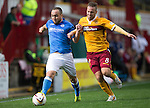 Motherwell v St Johnstone...30.08.14  SPFL<br /> Lee Croft fends off Paul Lawson<br /> Picture by Graeme Hart.<br /> Copyright Perthshire Picture Agency<br /> Tel: 01738 623350  Mobile: 07990 594431