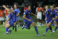 Italian defender (3) Fabio Grosso celebrates making the game-deciding penalty kick.  Italy defeated France on penalty kicks after leaving the score tied, 1-1, in regulation time in the FIFA World Cup final match at Olympic Stadium in Berlin, Germany, July 9, 2006.