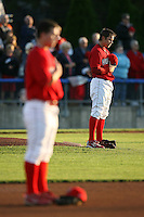 August 31, 2009:  Pitcher Michael Blazek of the Batavia Muckdogs stands during the National Anthem with Alan Ahmady in the foreground before a game at Dwyer Stadium in Batavia, NY.  The Muckdogs are the Short-Season Class-A affiliate of the St. Louis Cardinals.  Photo By Mike Janes/Four Seam Images