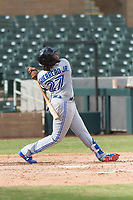 Surprise Saguaros third baseman Vladimir Guerrero Jr. (27), of the Toronto Blue Jays organization, follows through on his swing during an Arizona Fall League game against the Salt River Rafters at Salt River Fields at Talking Stick on October 23, 2018 in Scottsdale, Arizona. Salt River defeated Surprise 7-5 . (Zachary Lucy/Four Seam Images)