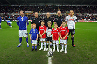 ATTENTION SPORTS PICTURE DESK<br /> Pictured: Garry Monk of Swansea City with young mascots <br /> Re: Coca Cola Championship, Swansea City Football Club v Leicester City at the Liberty Stadium, Swansea, south Wales. Saturday 16 January 2010