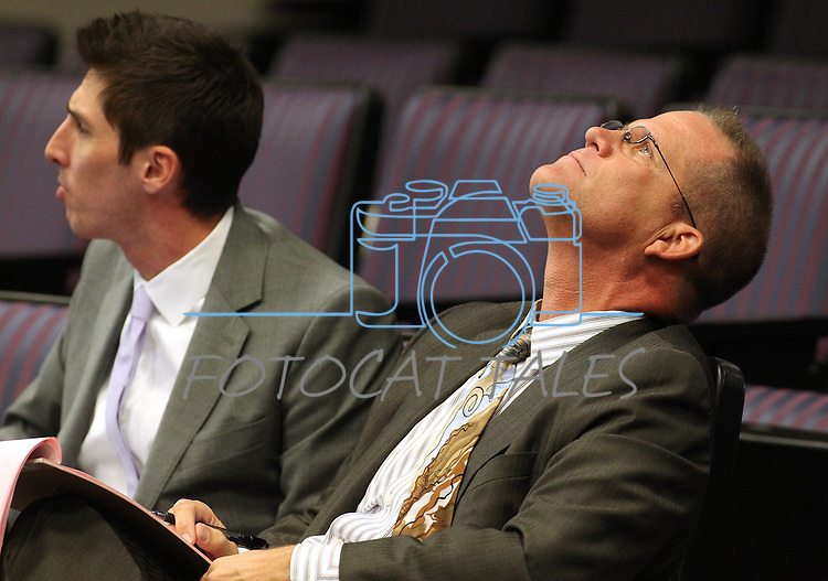 Attorney Mark Hutchison, representing the Nevada Republican Party, listens to discussion in a redistricting hearing at the Legislature in Carson City, NV. on Tuesday, Oct. 11, 2011. Ron Steslow is at left. .Photo by Cathleen Allison