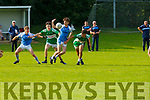 Colm O'Shea (12) and Stephen Palmer Firies and Callum O'Donoghue (4) and Senan O'Leary Legion contest the loose ball during their Minor in Firies on Monday