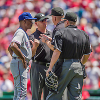 1 June 2014: Texas Rangers Manager Ron Washington discusses a play review with umpires during a game against the Washington Nationals at Nationals Park in Washington, DC. The Rangers shut out the Nationals 2-0 to salvage the third the third game of their 3-game inter-league series. Mandatory Credit: Ed Wolfstein Photo *** RAW (NEF) Image File Available ***