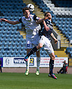 Caley's Ryan Christie and Dundee's Jim McAlister challenge for the high ball.