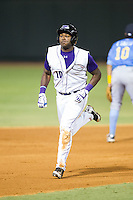 Courtney Hawkins (10) of the Winston-Salem Dash hustles towards third base against the Myrtle Beach Pelicans at BB&T Ballpark on July 16, 2014 in Winston-Salem, North Carolina.  The Pelicans defeated the Dash 6-2.   (Brian Westerholt/Four Seam Images)