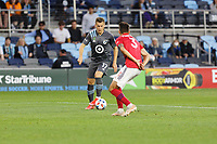 SAINT PAUL, MN - MAY 15: Robin Lod #17 of Minnesota United FC with Jose Martinez #3 of FC Dallas during a game between FC Dallas and Minnesota United FC at Allianz Field on May 15, 2021 in Saint Paul, Minnesota.