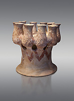 Cycladic Kernos a multiple vessel in a base.  Early Cycladic III (2300-2000 BC) , Phylakopi, Melos. National Archaeological Museum Athens. Cat No 5829.  Grey background.<br /> <br /> <br /> This complex vessel was used for ritual offerings. During this period pottery was plainer with simple geometric decorations. Depicts of birds or lowers were rare.