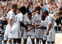 Pictured: Nathan Dyer (2nd R) of Swansea celebrating his opening goal with team mates. Saturday 23 August 2014<br />