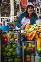 Peru, Cusco.  Juice Vendor, San Pedro Central Market.