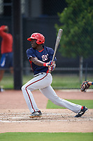 GCL Nationals left fielder Eric Senior (26) follows through on a swing during a game against the GCL Astros on August 6, 2018 at FITTEAM Ballpark of the Palm Beaches in West Palm Beach, Florida.  GCL Astros defeated GCL Nationals 3-0.  (Mike Janes/Four Seam Images)