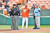 Clemson Tigers head coach Monte Lee (18) and North Carolina Tar Heels head coach Mike Fox (30) discuss ground rules with umpires Tony Walsh, Brandon Cooper, Scott Cline and Jeff Doy before a game between the North Carolina Tar Heels and Clemson Tigers at Doug Kingsmore Stadium on March 9, 2019 in Clemson, South Carolina. The Tigers defeated the Tar Heels 3-2 in game one of a double header. (Tony Farlow/Four Seam Images)