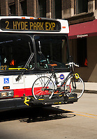 27 JUN 2014 - CHICAGO, USA - A bike rack for passengers bikes on the front of a bus in Chicago in the USA (PHOTO COPYRIGHT © 2014 NIGEL FARROW, ALL RIGHTS RESERVED)