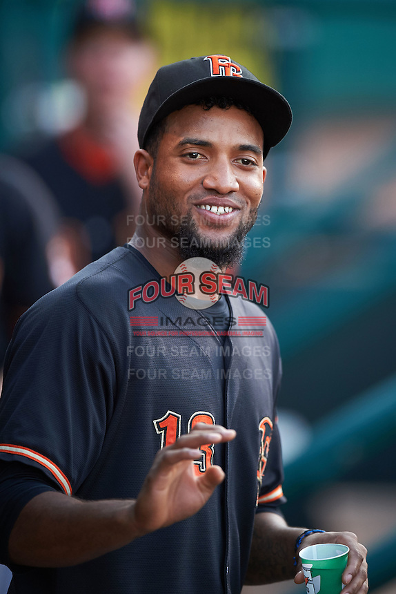 Fresno Grizzles outfielder Domingo Santana (13) in the dugout during a game against the Oklahoma City Dodgers on June 1, 2015 at Chickasaw Bricktown Ballpark in Oklahoma City, Oklahoma.  Fresno defeated Oklahoma City 14-1.  (Mike Janes/Four Seam Images)