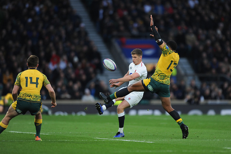 Owen Farrell (c) of England chips over the head of Samu Kerevi of Australia during the Quilter International match between England and Australia at Twickenham Stadium on Saturday 24th November 2018 (Photo by Rob Munro/Stewart Communications)