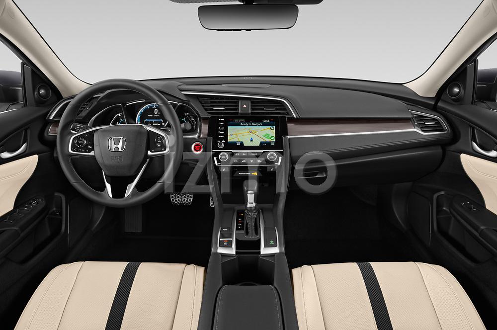Stock photo of straight dashboard view of 2019 Honda Civic-Sedan Touring 4 Door Sedan Dashboard