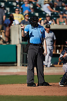 Home plate umpire Jacob McConnell makes a strike call during the game between the Augusta GreenJackets and the Charleston RiverDogs at Joseph P. Riley, Jr. Park on June 27, 2021 in Charleston, South Carolina. (Brian Westerholt/Four Seam Images)