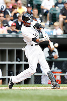 Chicago White Sox Alexei Ramirez #10 makes contact at bat during a game against the Kansas City Royals at U.S. Cellular Field on August 14, 2011 in Chicago, Illinois.  Chicago defeated Kansas City 6-2.  (Mike Janes/Four Seam Images)