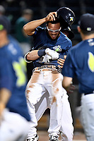 Pinch runner Desmond Lindsay (2) of the Columbia Fireflies is lifted up by a teammate after scoring the winning run in the 10th inning of a game against the West Virginia Power on Thursday, May 18, 2017, at Spirit Communications Park in Columbia, South Carolina. (Tom Priddy/Four Seam Images)