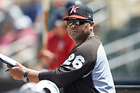 Kannapolis Intimidators hitting coach Jamie Dismuke (26) watches the action from the dugout during the game against the Greensboro Grasshoppers at Kannapolis Intimidators Stadium on August 5, 2018 in Kannapolis, North Carolina. The Grasshoppers defeated the Intimidators 2-1 in game one of a double-header.  (Brian Westerholt/Four Seam Images)