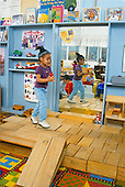 MR/Schenectady, New York.Yates Arts Magnet School- Pre-Kindergarten.Girl (4, African-American and Caucasian) sings and dances at free play time on platform of blocks, pretending she is on stage..MR:Lon1.PN#:29050      FC#:23073-00119.scan from slide .© Ellen B. Senisi