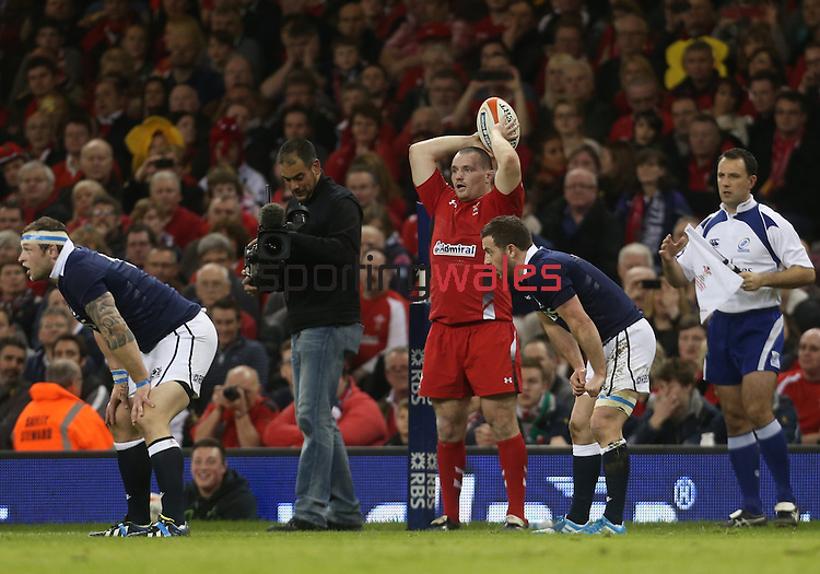 Wales hooker Ken Owens throws in at the line out.<br /> RBS 6 Nations 2014<br /> Wales v Scotland<br /> Millennium Stadium<br /> <br /> 15.03.14<br /> <br /> ©Steve Pope-SPORTINGWALES