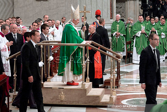 Pope Benedict XVI leaves on a mobile platform after a mass at Saint Peter Basilica in The Vatican, part of a major Vatican conference on evangelisation on October 16, 2011.