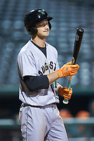 Jacob Gonzalez (18) of the Augusta GreenJackets checks his bat before stepping into the batters box during the game against the Greensboro Grasshoppers at First National Bank Field on April 10, 2018 in Greensboro, North Carolina.  The GreenJackets defeated the Grasshoppers 5-0.  (Brian Westerholt/Four Seam Images)