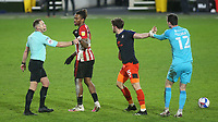 Luton goalkeeper, Simon Slugo, tries to prevent Tom Lockyer from continuing his argument with Brentford's Ivan Toney. Moments later, referee Stephen Martin, sent off Toney and Lockyer during Brentford vs Luton Town, Sky Bet EFL Championship Football at the Brentford Community Stadium on 20th January 2021