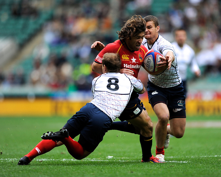 Carlos Blanco of Spain is tackled by Alexander Yanyuskin of Russia during the iRB Marriott London Sevens at Twickenham on Saturday 11th May 2013 (Photo by Rob Munro)