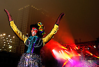 Performers entertain New Year's Eve revelers waiting to welcome in 2010 in downtown Charlotte NC during First Night Charlotte 2010. The family-friendly public event (no alcohol allowed) is an annual cultural New Year's Eve celebration held in downtown / uptown / Charlotte center city. Charlotte First Night - An Imagination Celebration brought together artists, musicians, dancers and more from across the country. The New Year's event is organized by Charlotte Center City Partners, which facilitates and promotes the economic and cultural development of this North Carolina urban core.