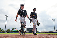 FCL Pirates Black catcher Henry Davis (32) walks to the dugout with starting pitcher Cristopher Cruz (30) before a game against the FCL Rays on August 3, 2021 at Charlotte Sports Park in Port Charlotte, Florida.  Davis was making his professional debut after being selected first overall in the MLB Draft out of Louisville by the Pittsburgh Pirates.  (Mike Janes/Four Seam Images)