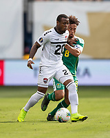 KANSAS CITY, KS - JUNE 26: Jomal Williams #20 tries to control the ball in front of Samuel Cox #8 during a game between Guyana and Trinidad