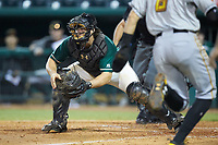 Greensboro Grasshoppers catcher J.D. Osborne (46) waits for a throw as Robbie Glendinning (6) of the West Virginia Power heads towards home plate at First National Bank Field on August 9, 2018 in Greensboro, North Carolina. The Power defeated the Grasshoppers 9-7 in game two of a double-header. (Brian Westerholt/Four Seam Images)