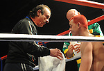 Enzo Calzaghe gives his fighter Hari Miles instructions after the first round. Hari Miles ( Red with Black stripe ) V Nick Okoth (Black flame shorts). Joe Calzaghe Promotions Boxing Evening .Date: Friday 20/11/2009,  .© Ian Cook IJC Photography, 07599826381, iancook@ijcphotography.co.uk,  www.ijcphotography.co.uk, .