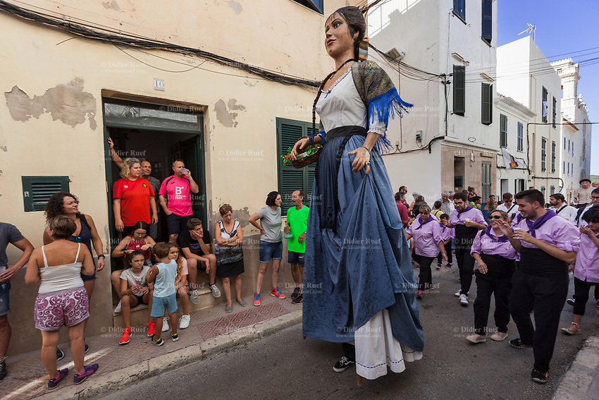 """Spain. Balearic Islands. Minorca (Menorca). Mahon. The parade of the Giants in the """"Festes de la Mare de Déu de Gràcia"""" during the traditional summer festival. Maó (in Catalan) and Mahón (in Spanish), written in English as Mahon, is a municipality, the capital city of the island of Menorca, and seat of the Island Council of Menorca. The city is located on the eastern coast of the island, which is part of the autonomous community of the Balearic. In Spain, an autonomous community is a first-level political and administrative division, created in accordance with the Spanish constitution of 1978, with the aim of guaranteeing limited autonomy of the nationalities and regions that make up Spain. 7.09.2019 © 2019 Didier Ruef"""