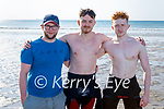 Mad for surf in Banna beach on Thursday, l to r: Christopher Thomas, Callum McCarthy and Michael O'Donnell.