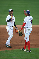 Potomac Nationals center fielder Victor Robles (16) high fives Kelvin Gutierrez (3) after closing out the first game of a doubleheader against the Salem Red Sox on May 13, 2017 at G. Richard Pfitzner Stadium in Woodbridge, Virginia.  Potomac defeated Salem 6-0.  (Mike Janes/Four Seam Images)
