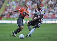 Swansea City's Tom Carroll vies for possession with Sheffield United's Leon Clarke during the Sky Bet Championship match between Sheffield United and Swansea City at Bramall Lane, Sheffield, England, UK. Saturday 04 August 2018