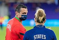 ORLANDO, FL - JANUARY 22: Vlatko Andonovski talks with Emily Sonnett #14 of the USWNT before a game between Colombia and USWNT at Exploria stadium on January 22, 2021 in Orlando, Florida.